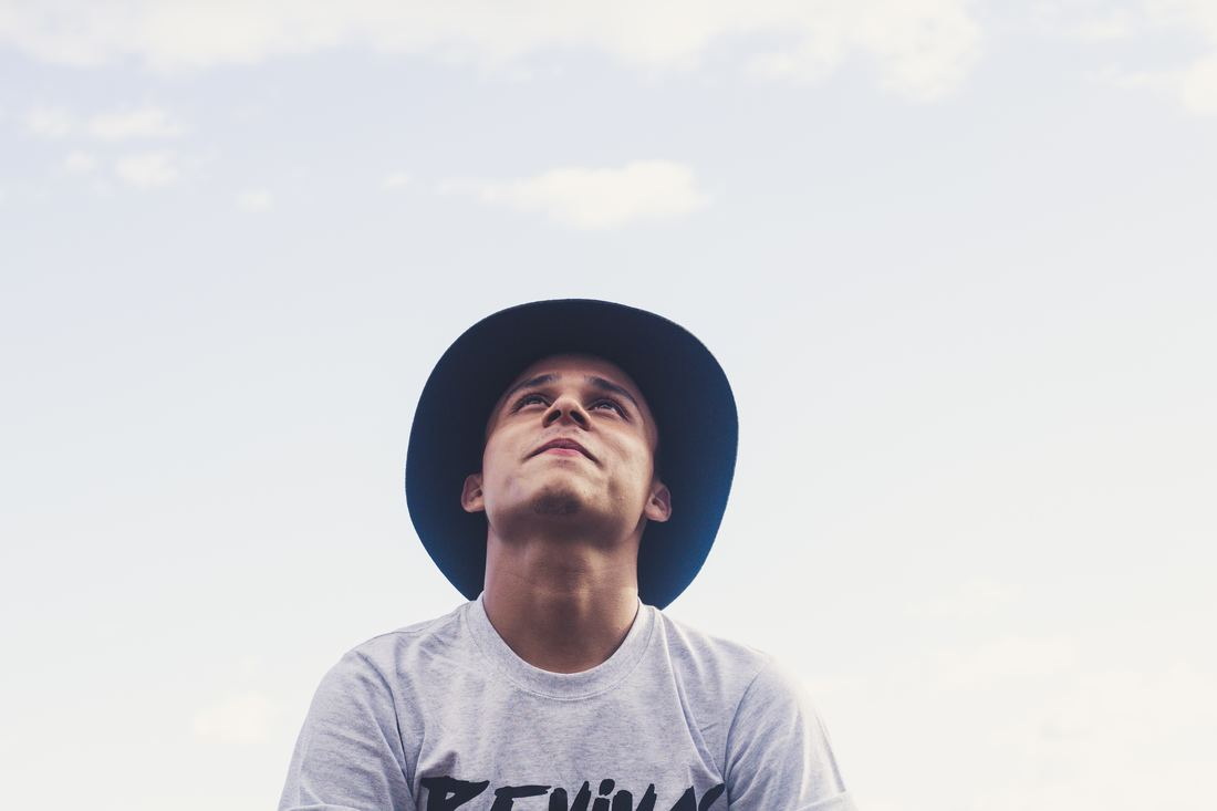 Young man looking to the sky